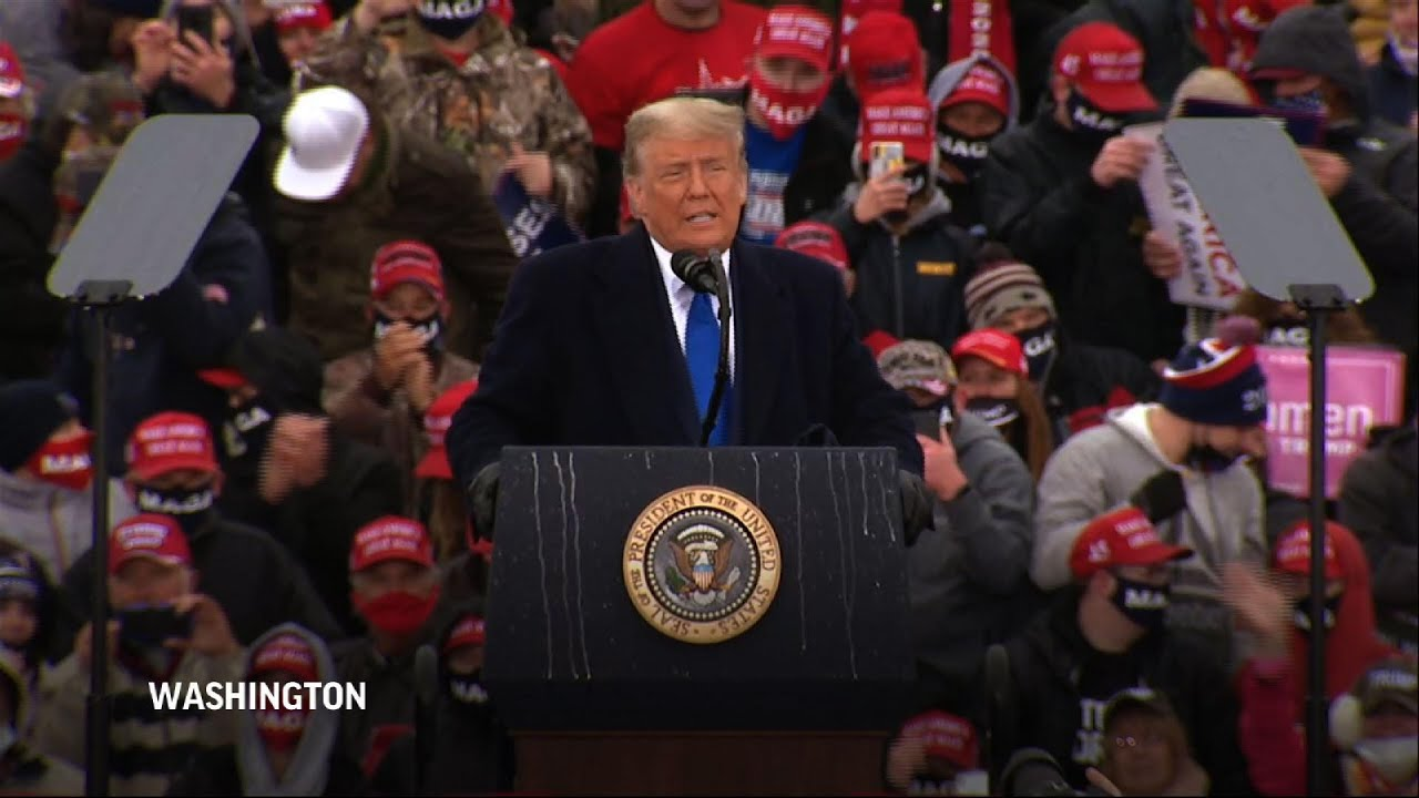 Trump campaigns at rain-soaked Michigan rally