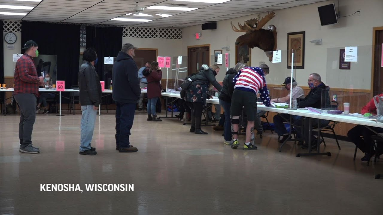 Divided Wisconsin voters cast their ballots