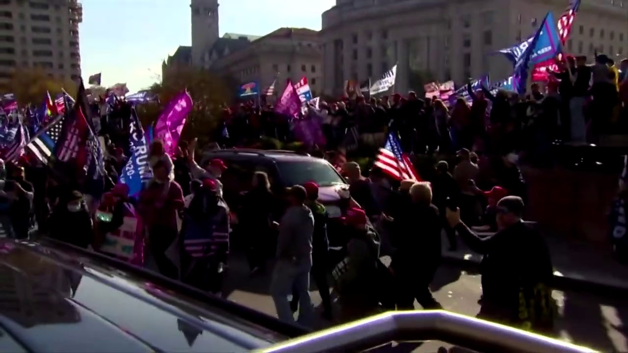 Cheers greet Trump's convoy at D.C. protests