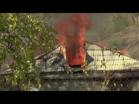 Armenians set homes on fire before Azeri handover