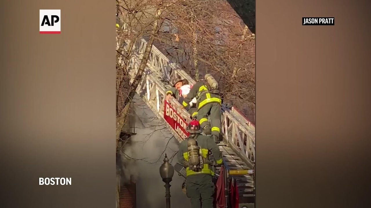 Boston firefighters rescue child from burning home