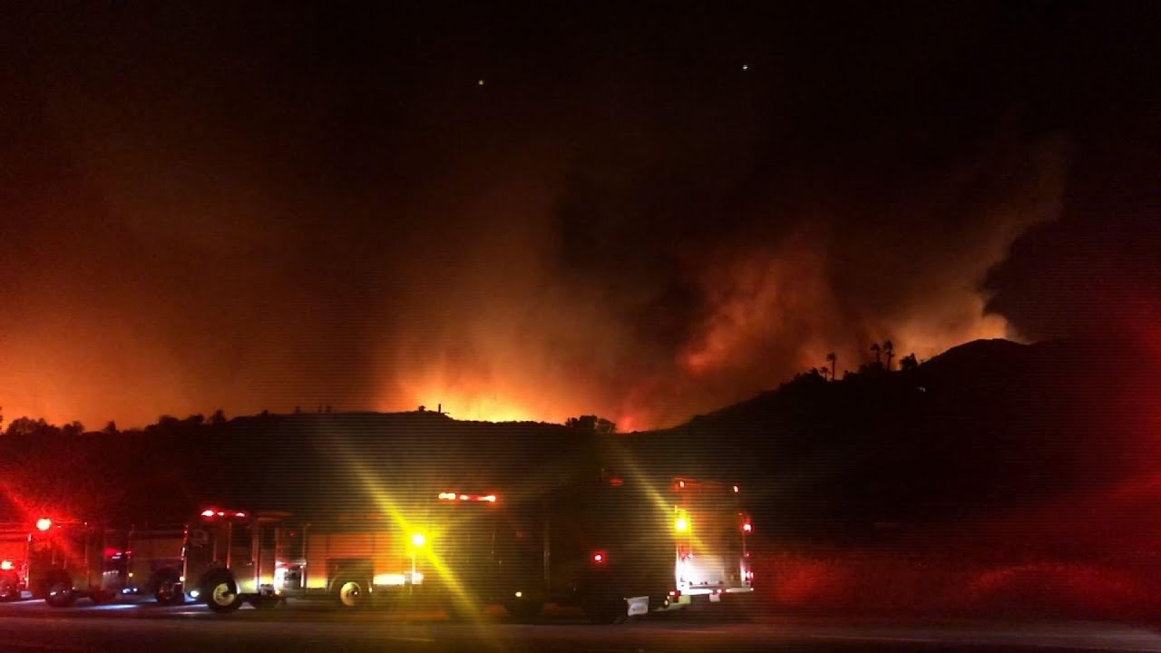 Wind swept wildfires rage in Southern California