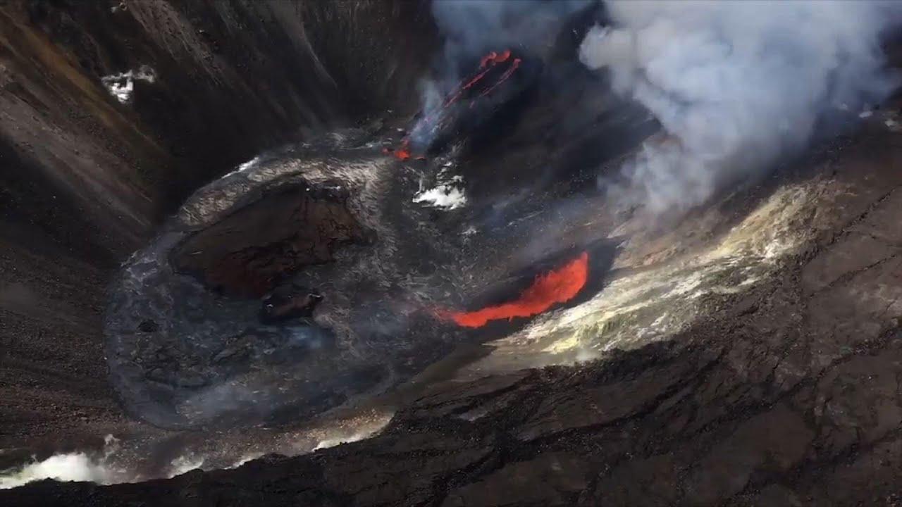 Chopper peers into cone of erupting volcano