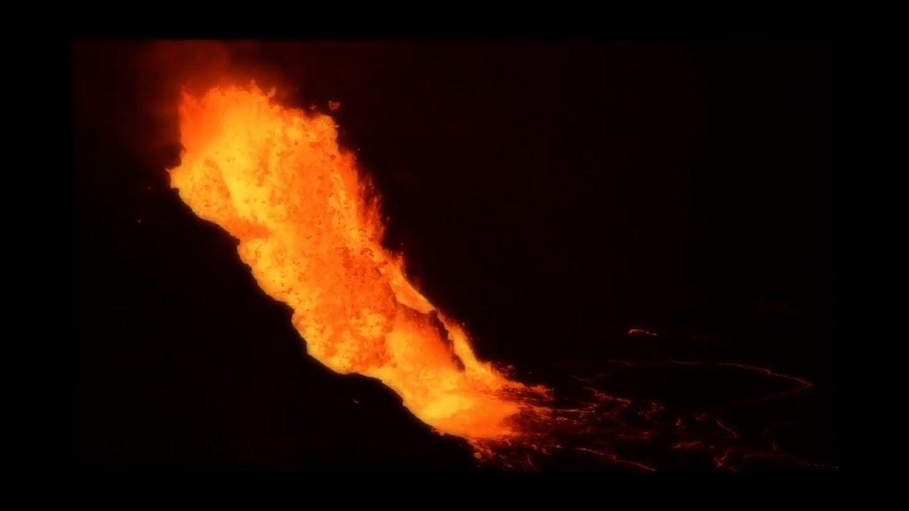 Lava cascades into molten lake in volcano's crater