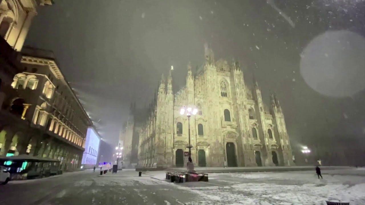 Rare snowfall blankets locked-down Milan