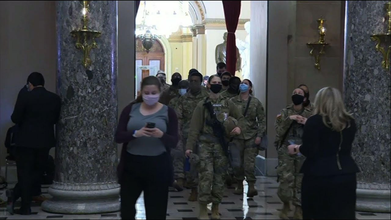 Armed National Guard arrive at the Capitol