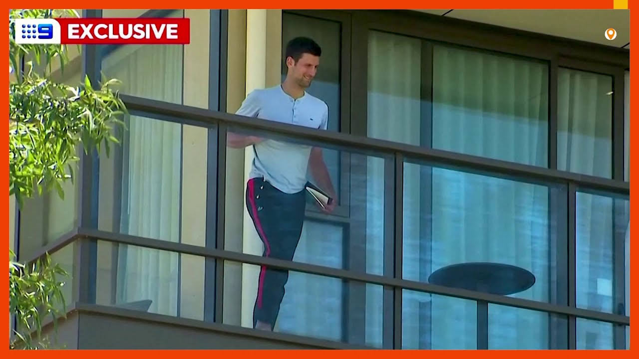 Djokovic watches young tennis players from hotel balcony