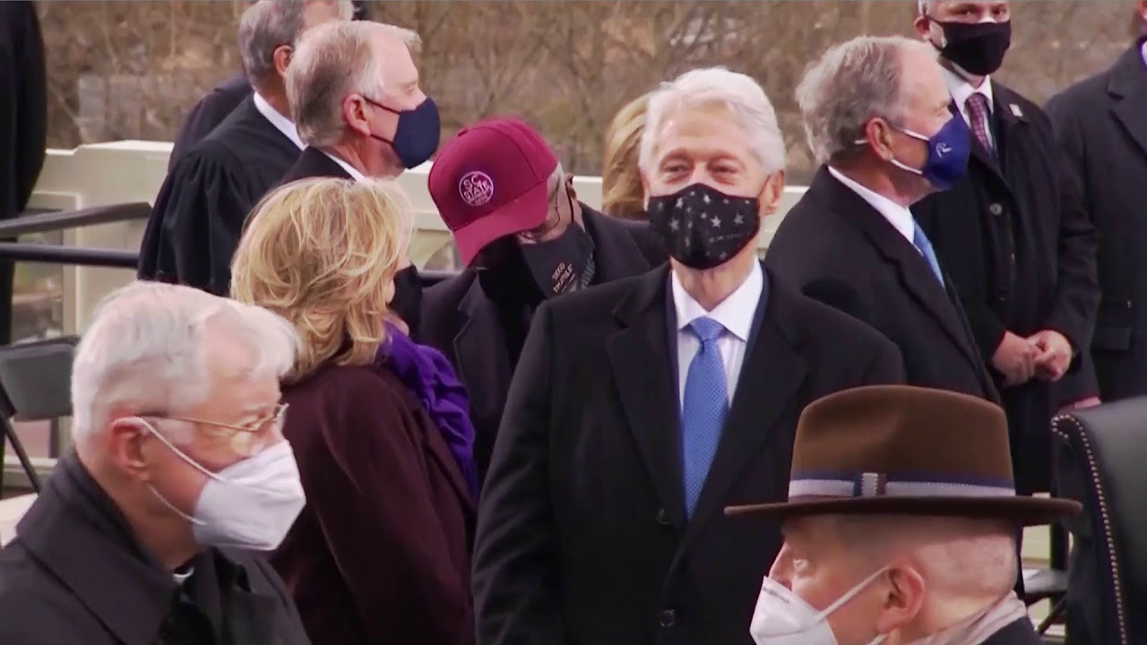 Former presidents bump fists, elbows at inauguration