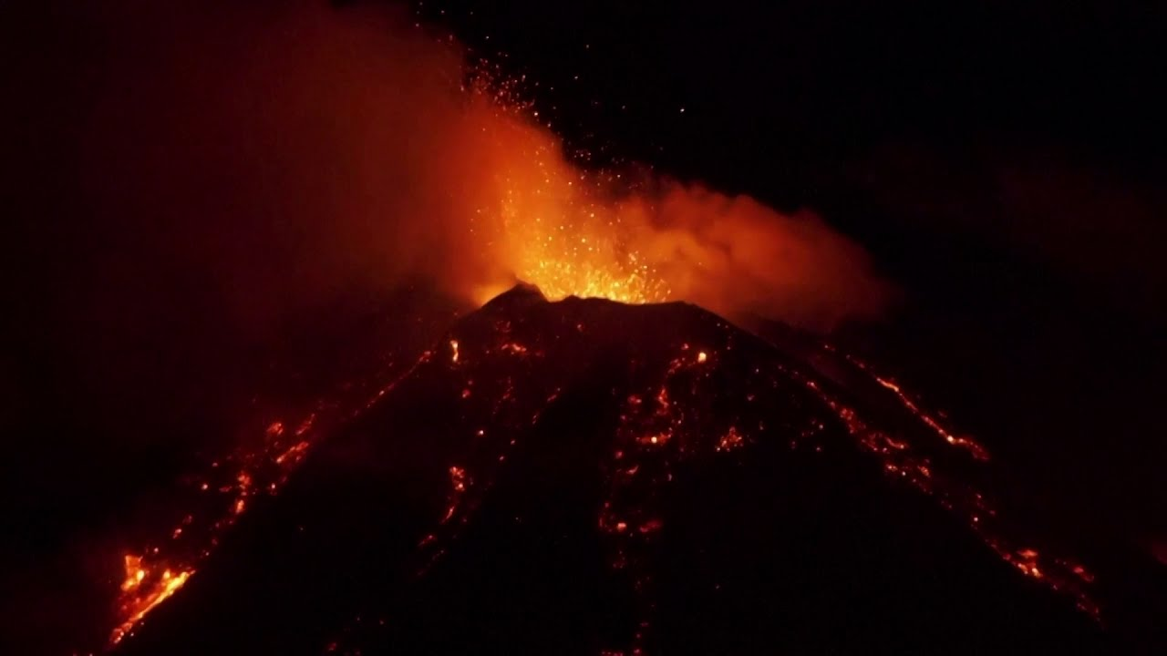 Italy's Mount Etna erupts at night time