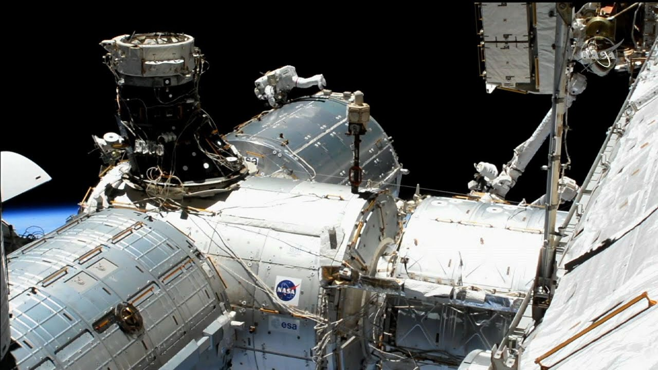 NASA astronauts conduct spacewalk to upgrade ISS