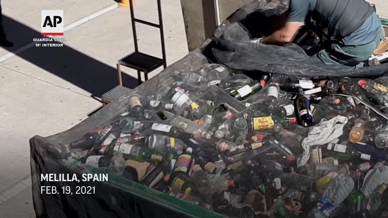 Spain police rescue migrants hidden in containers