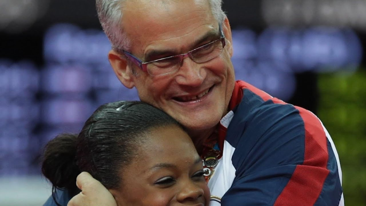 Ex-US gymnastics coach with Nassar ties is charged