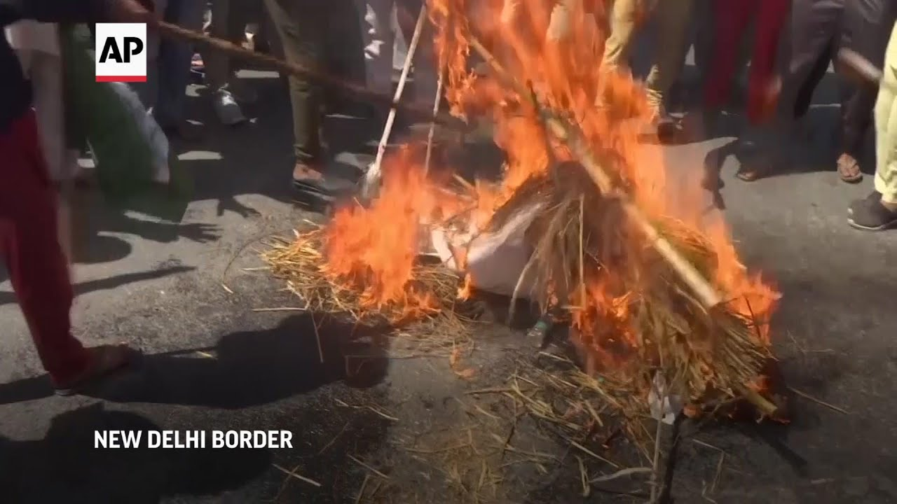 Indian farmers protest new laws with road block