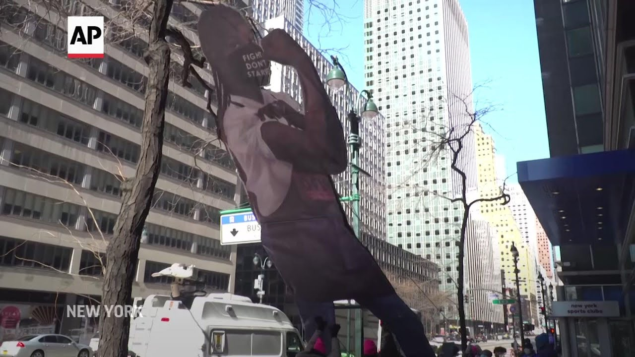 Protesters raise sculpture at Cuomo's NYC office