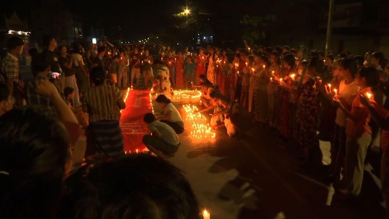 Hundreds gather for candlie-lit Yangon night rally
