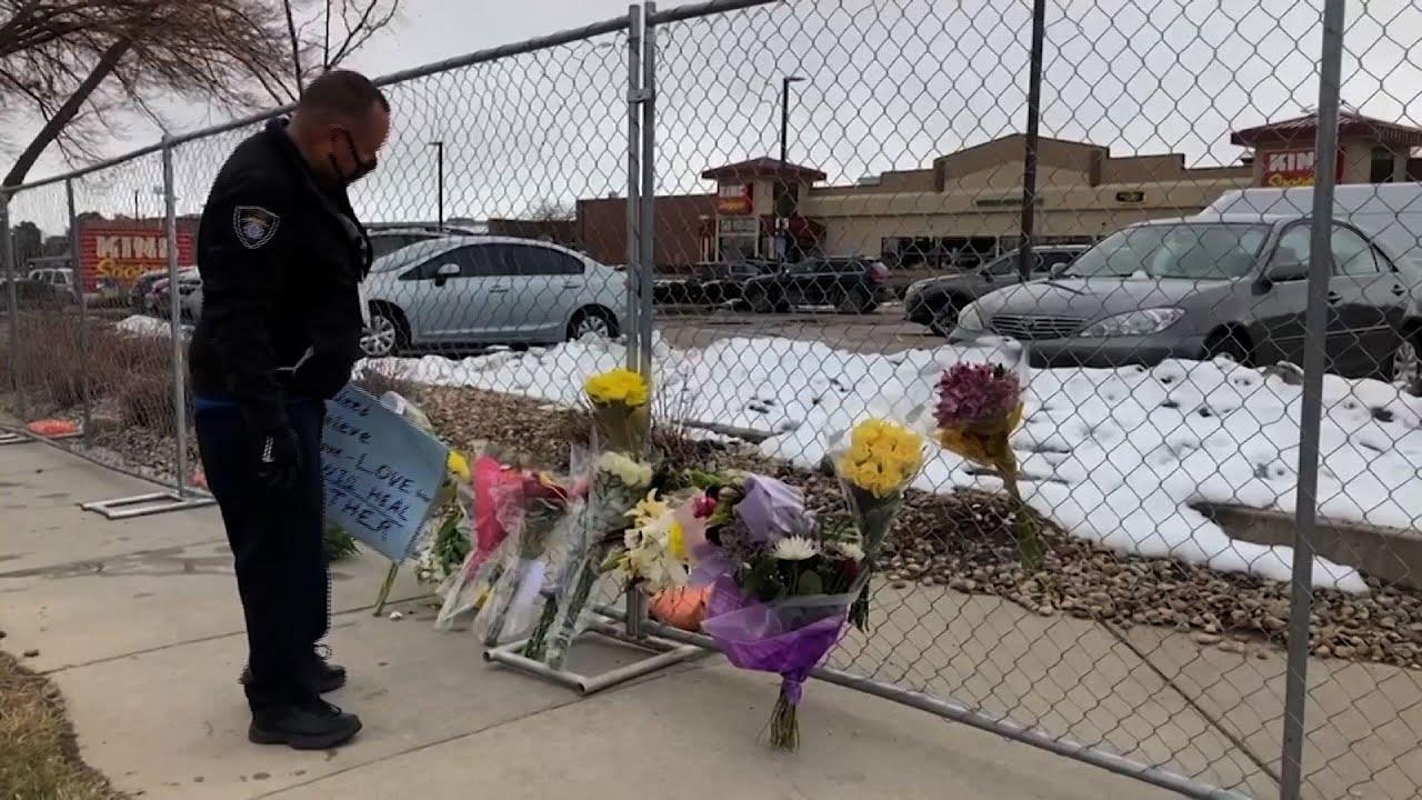 Flowers mark scene of deadly Colorado shooting