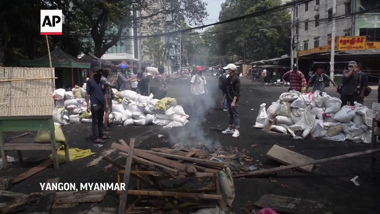 Protestors, some armed, build barricades in Yangon