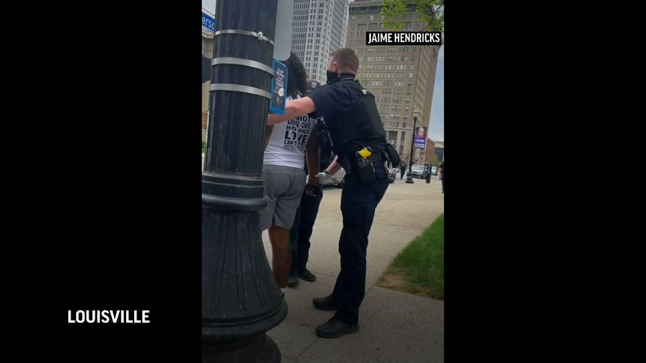 Video shows Louisville officer punching protester