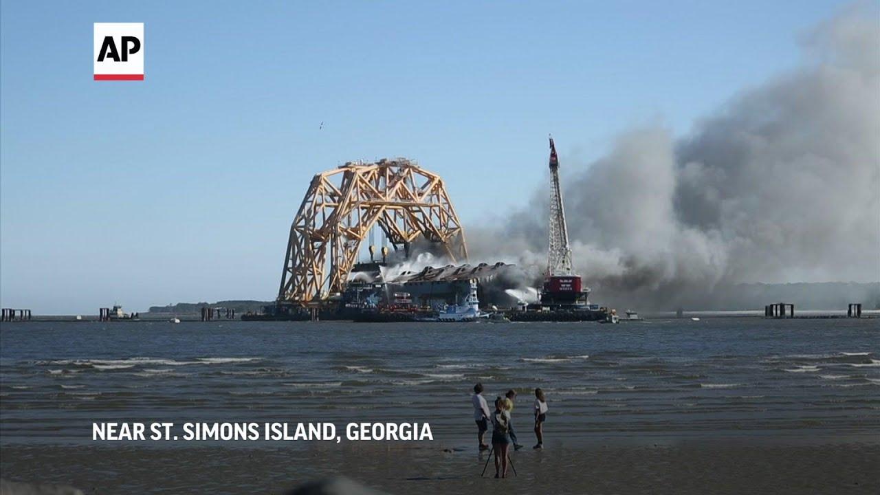Flames engulf cargo ship's remains off US coast